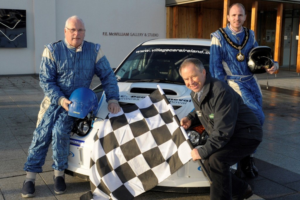 Lord Mayor of Armagh City, Banbridge and Craigavon, Cllr Darryn Causby (back, right) helps launch the Circuit of Ireland Rally in Banbridge with Event Director, Bobby Willis (front, left) and local rally driver Kenny McKinstry (right).