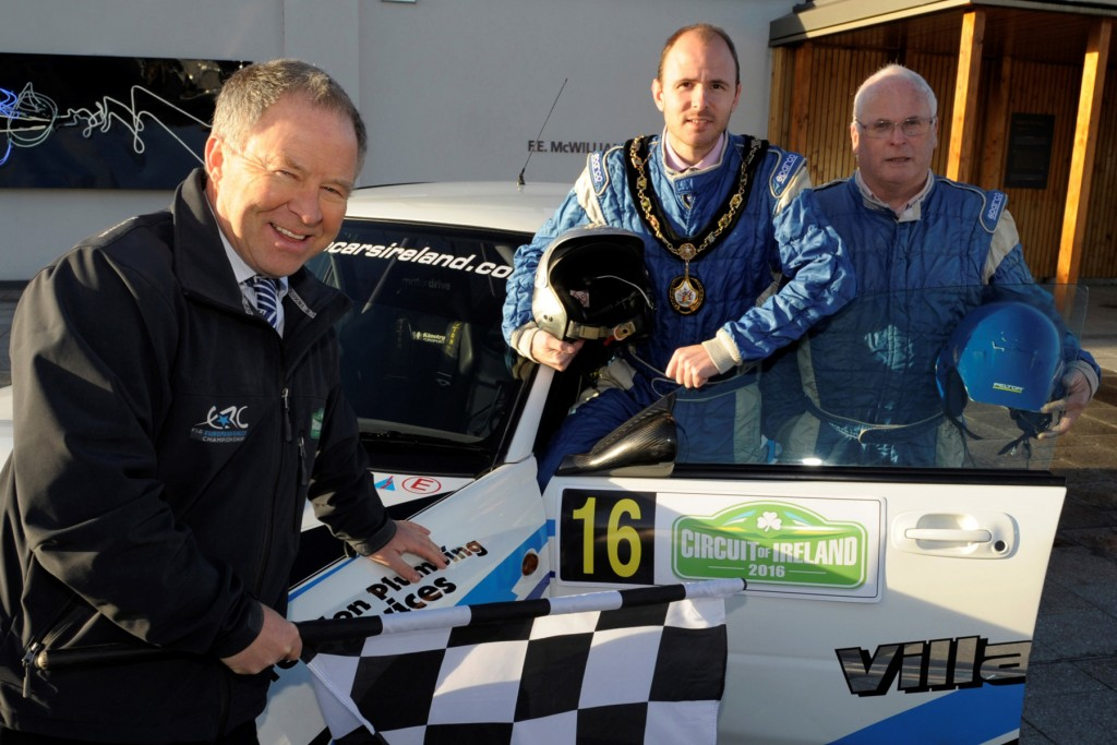 Lord Mayor of Armagh City, Banbridge and Craigavon, Cllr Darryn Causby (2nd, right) helps launch the Circuit of Ireland Rally in Banbridge with Event Director, Bobby Willis (left) and local rally driver Kenny McKinstry (right).