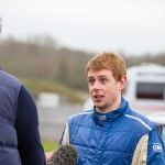 Driver Stephen Wright enjoys a television interview