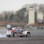 Stephen Wright in his Ford Fiesta R5 burning some rubber in front of the old H block