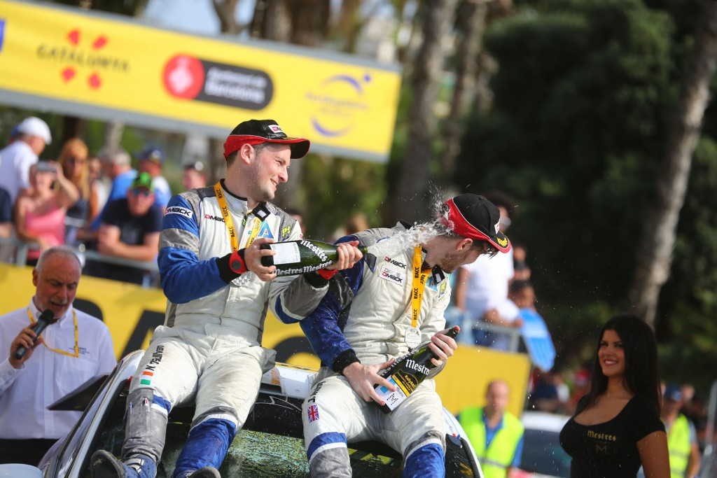 Jon & Niall enjoying a well earned and long overdue spraying of bubbly -WRC Spain (SPA) - WRC 13/10/2016 to 16/10/2016 - PHOTO : @World