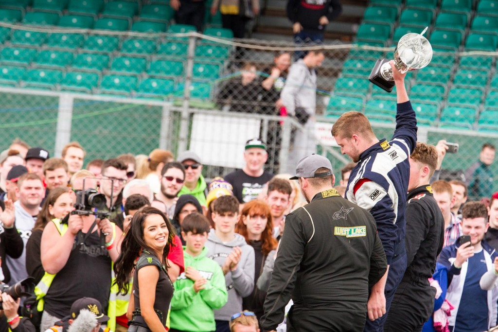 Duane McKeever lifts his winners trophy with Tomas Kiely and Jack Shanahan finishing off the rostrum