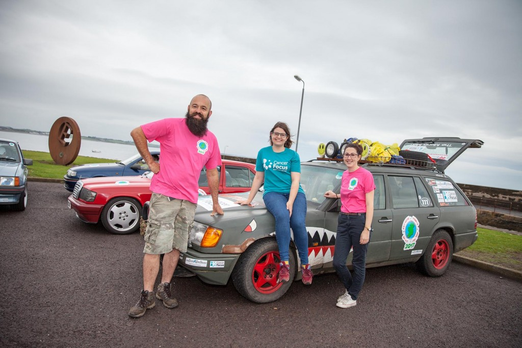 Organisers Stewart Rea and Melissa Dunn with Cancer Focus NI's Community Fundraising Officer Lianne Mulholland (centre) at the rally's start point of Burr Point, Ballyhalbert this morning (Friday 25), mainland Ireland's most easterly point.