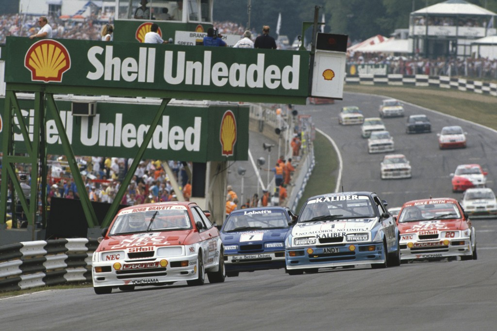 1989 British Touring Car Championship. Brands Hatch, England. 23rd July 1989. Rd 8. Robb Gravett (Ford Sierra RS500),1st position, leads Andy Rouse (Ford Sierra RS500), 2nd position and Mike Smith (Ford Sierra RS500), 3rd position, at the start of the race, action.  World Copyright: LAT Photographic. Ref:  89BTCC BH04