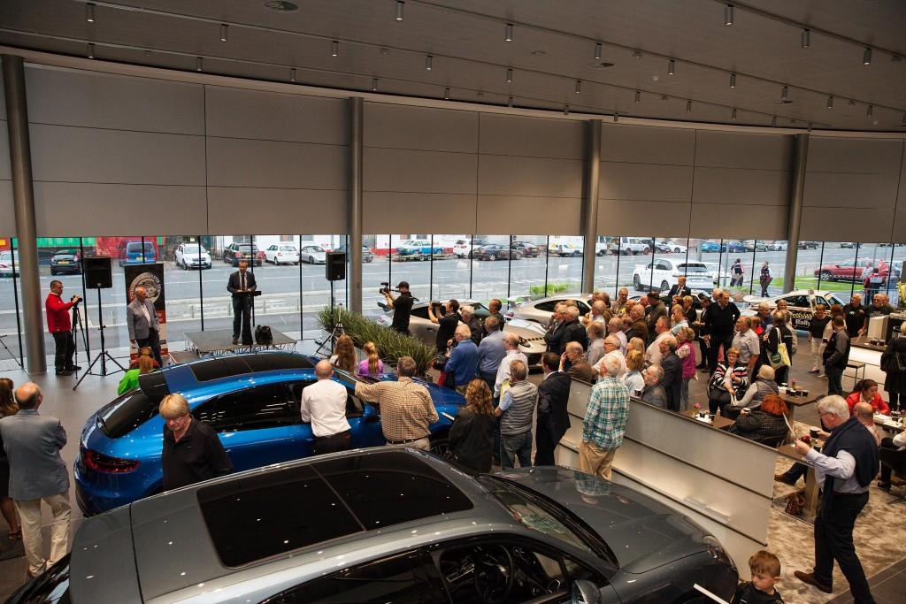 Large crowds gathered in Porsche Belfast at the opening of Titanic Déjà vu Ulster...
