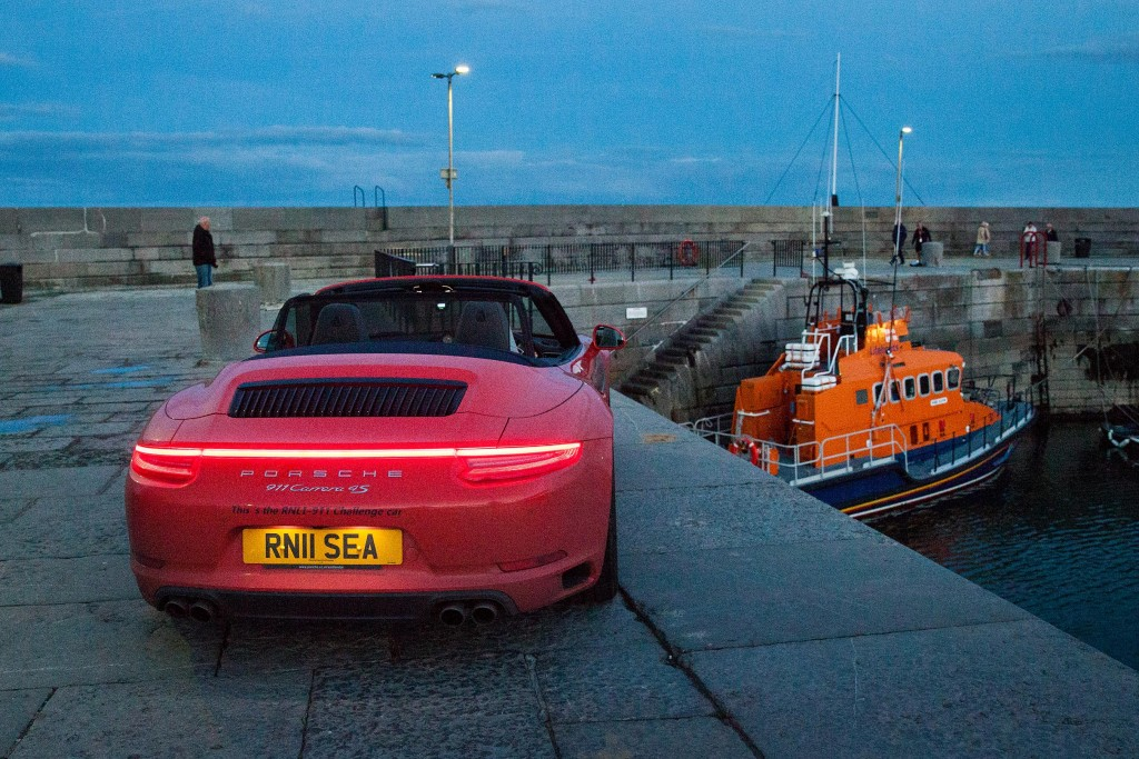 The RNLI Porsche 911 Challenge car, Splash, with the Donaghadee RNLI Trent-class lifeboat 'Saxon' 14-36.