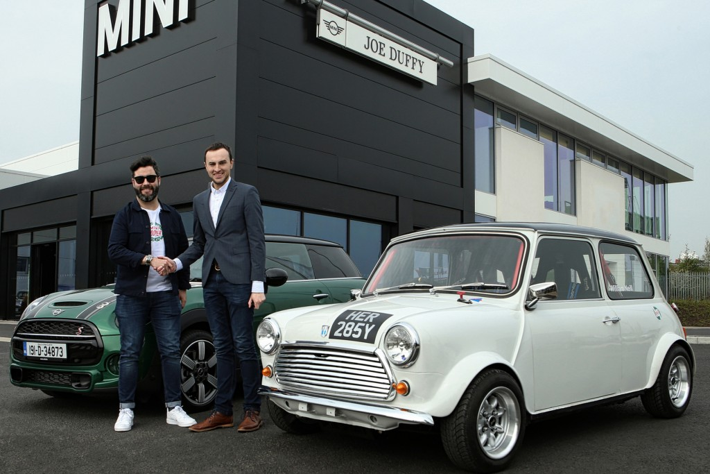From left Austin Behan, General Manager for MINI Ireland and William Neill, MINI Magic Event Director shake hands on the sponsorship of the September 15 track day and meet open to road, rally and track MINIS, taking place at White River Park, Collon, County Louth.