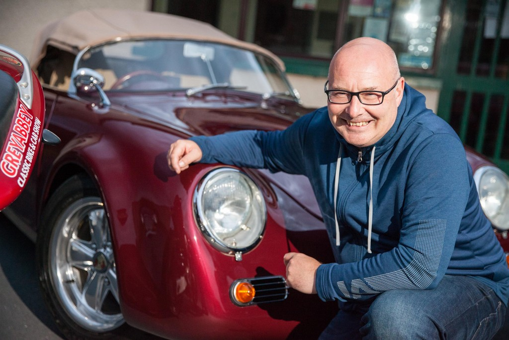 Show organiser, Paul Taggart, in a classic Porsche at Greyabbey Village Hall at the launch of this year's Classic Bike & Car Show, set to he held at the venue on Saturday 24 August...