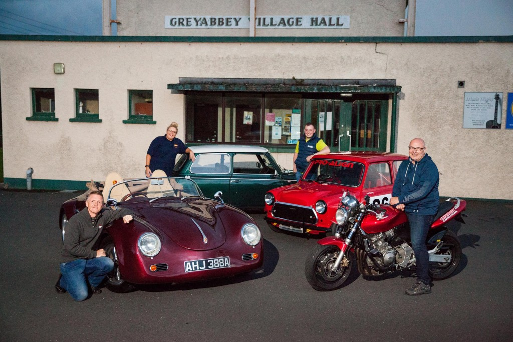 An array of vehicles on display at Greyabbey Village Hall at the launch of this year's Classic Bike & Car Show, set to he held at the venue on Saturday 24 August. Pictured L-R: Kenny Crossan; Joanne Andrews; Lewis Dunlop; Paul Taggart.