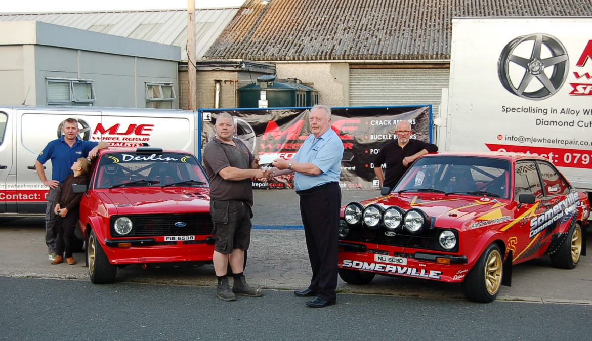 Jason Stirrup (MJE Wheel Repair Specialists) presents sponsorship cheque to Bob McKeown (Clerk of the Course) for the MJE Wheel Repair Tyrone Stages Rally.